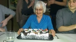 Betty Nicolson blowing out candles on a birthday cake