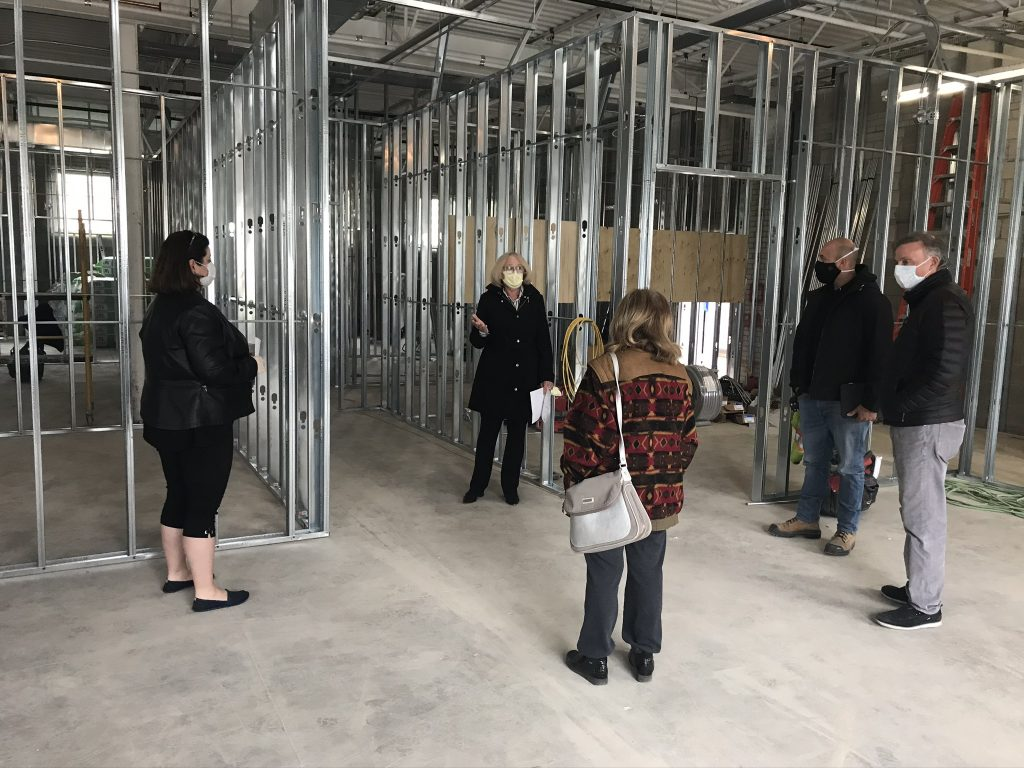 ESS CEO leading a tour through the construction site of our Senior Care Centre.