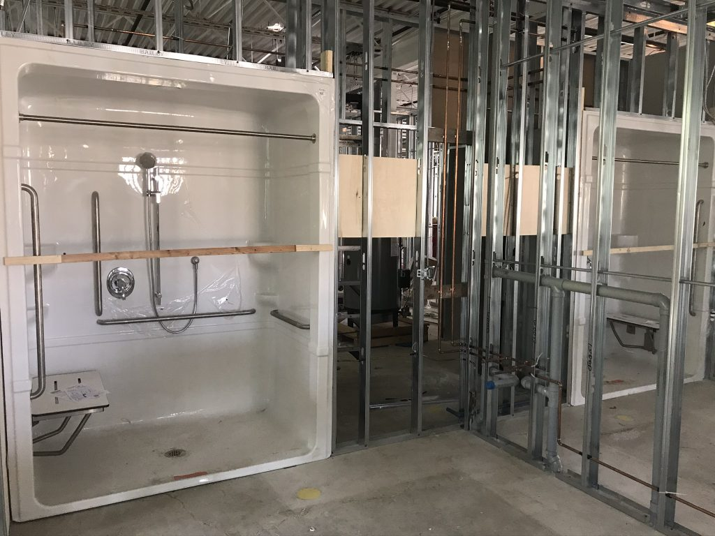 Beginning stages of the construction process of our Senior Care Centre. Pictured is the new shower being installed.